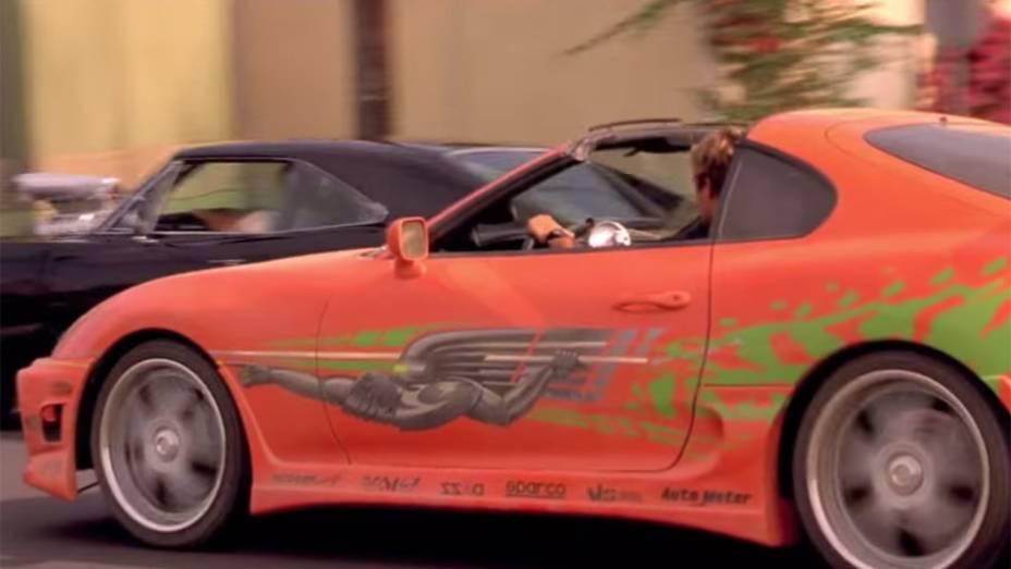 Toyota Supra: possivelmente o carro mais emblemático de toda a saga, este esportivo foi dirigido por Brian OConnor (Paul Walker) na famosa cena final de Velozes e Furiosos (2001)
