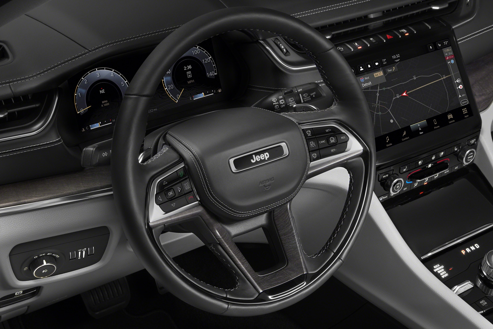 The all-new 2021 Jeep® Grand Cherokee L Overland leather-wrapped multifunction steering wheel complements the new finely crafted leather-wrapped, stitched instrument panel.