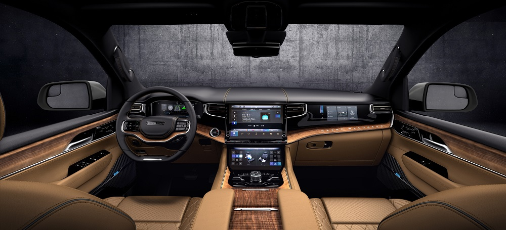 All-new 2022 Grand Wagoneer features the pinnacle of premium SUV interiors (seen here in Tupelo) with a modern American style and Uconnect 5 12-inch touchscreen radio.