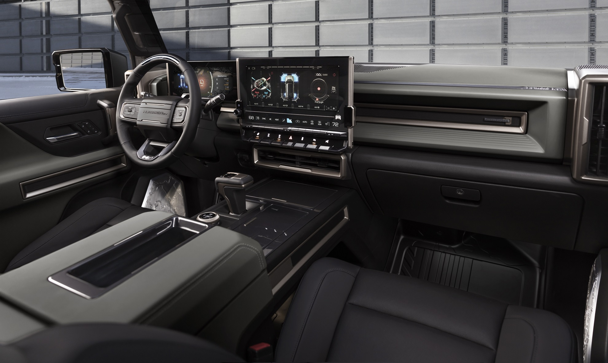 The GMC HUMMER EV SUV debuts in the low-contrast Lunar Shadow interior and includes a spacious cargo area and an architecturally inspired cabin.