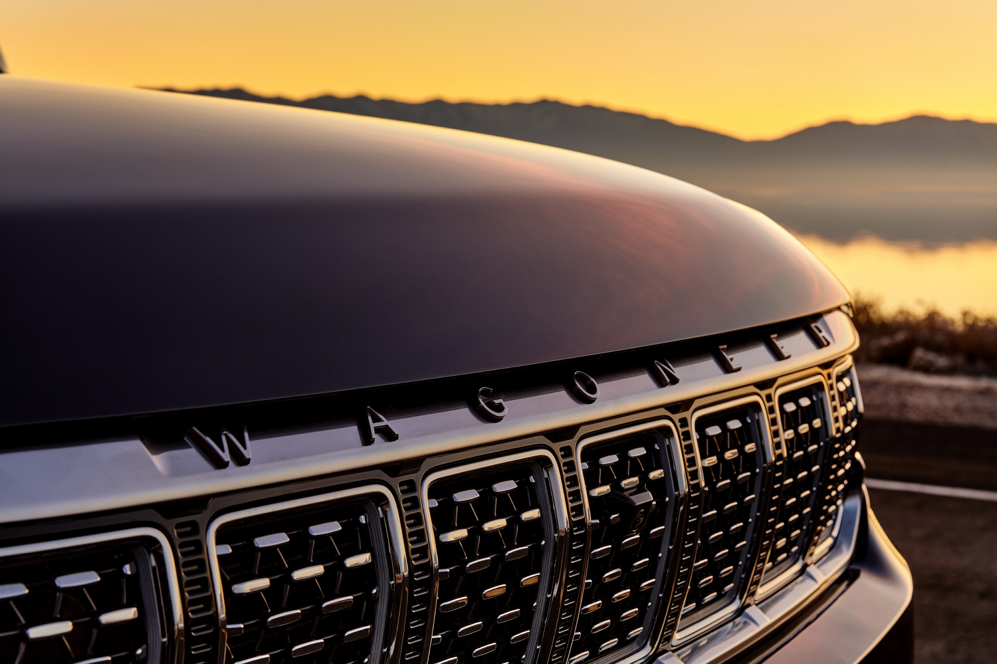 All-new 2022 Grand Wagoneer features the legendary seven-slot grille hinting at family ties and, on Grand Wagoneer models, features paint-over-chrome laser-etched grille rings, similar to a knurled finish seen on fine watches.