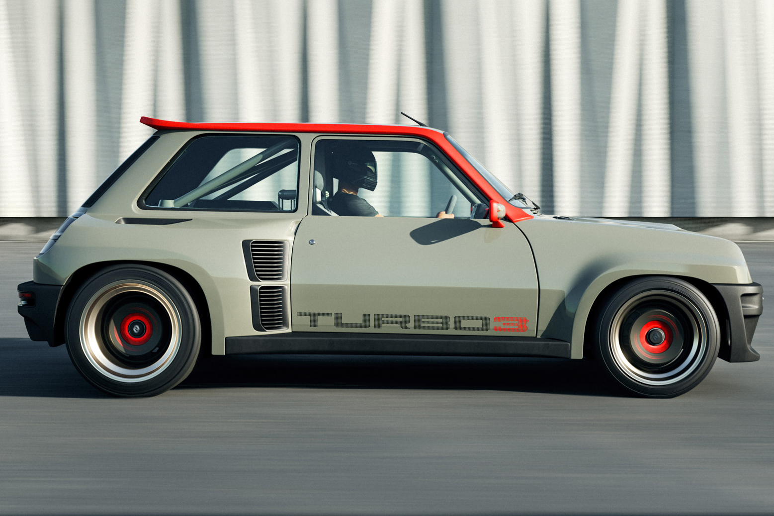 Renault 5 Turbo 3 cinza e laranja visto de lado